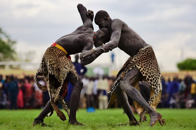 """Wrestlers from Jonglei and eastern lakes region take part in the South Sudan national wrestling competition for peace at Juba stadium, South Sudan, on April 20, 2016. South Sudan is holding a """"wrestling for peace"""" tournament, bringing together athletes from around the country. Carl de Souza/AFP"""